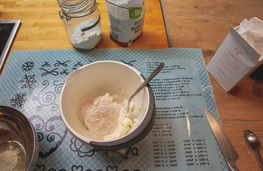flour, white cheese and other ingredients for lazy dumplings on the countertop
